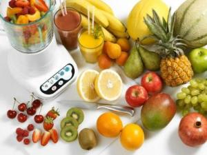 Array of Fresh Fruits Next to Blender --- Image by © Steve Lupton/Corbis